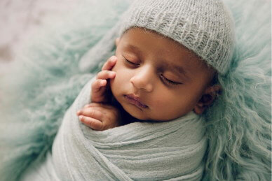 Baby-boy-wrapped-and-sleeping-on-his-back-photographed-by-Victoria-Burcuse