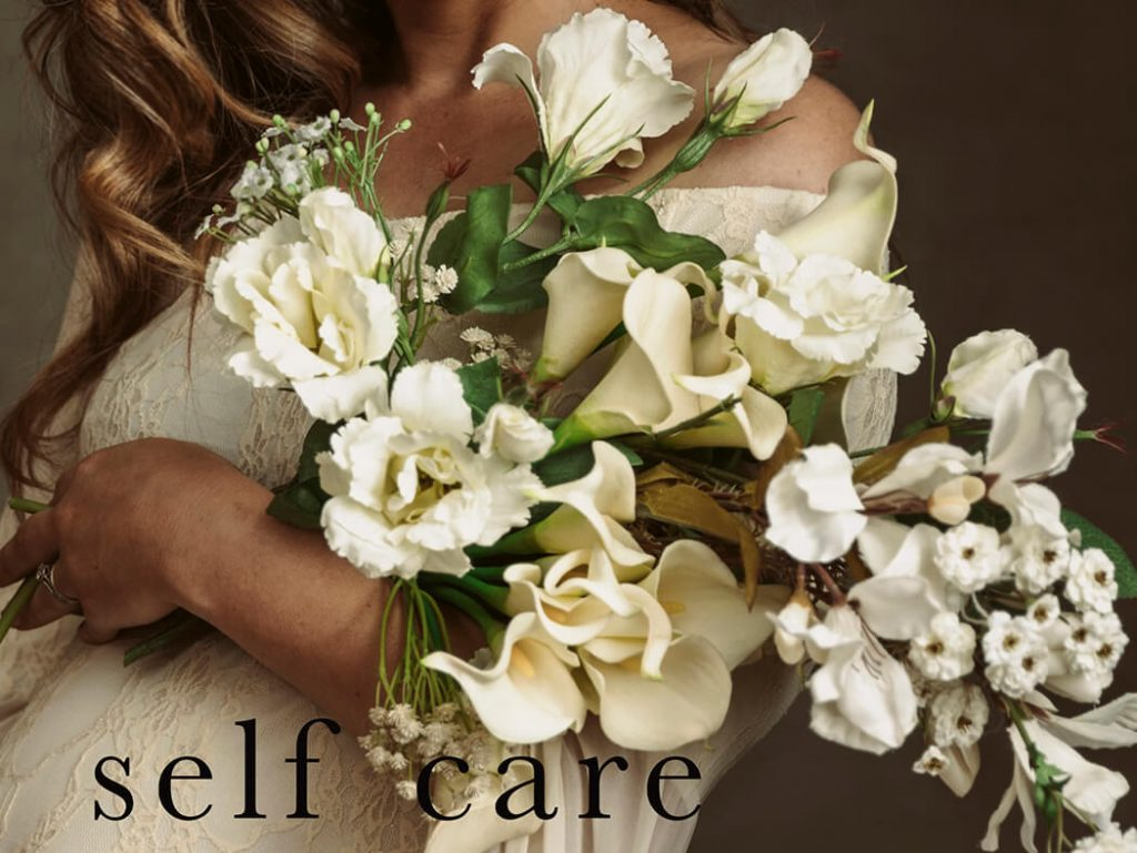 A mama holding flowers in her arms, photographed by Victoria Burcusel from Lifetime Stories Photography
