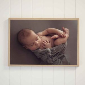 a newborn image Framed in a Wood Canvas