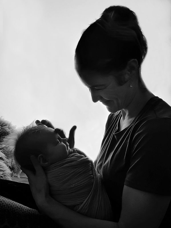 Portrait of a photographer with a newborn